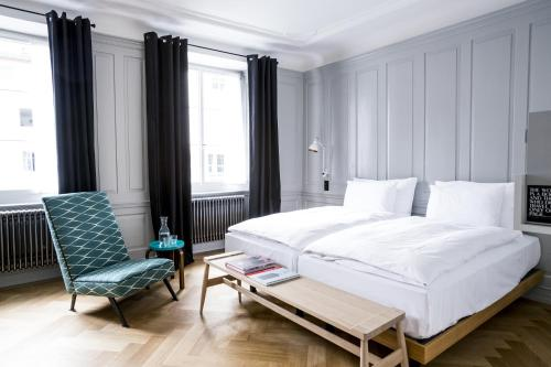 A bed or beds in a room at Marktgasse Hotel
