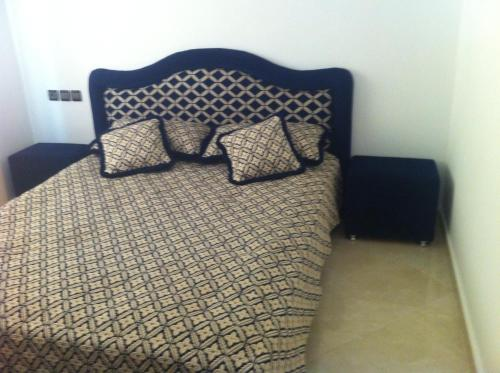 A bed or beds in a room at Apartment Fes