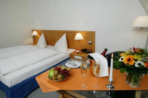 Ein Bett oder Betten in einem Zimmer der Unterkunft Stadthotel Oranienburg