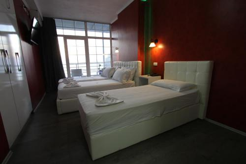 A bed or beds in a room at Aparthotel Espana