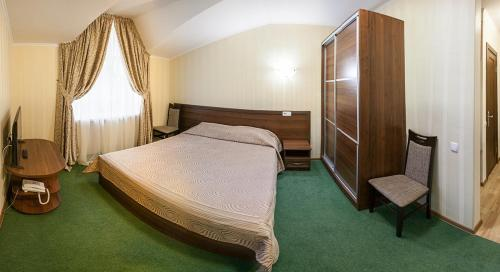 A bed or beds in a room at Arena
