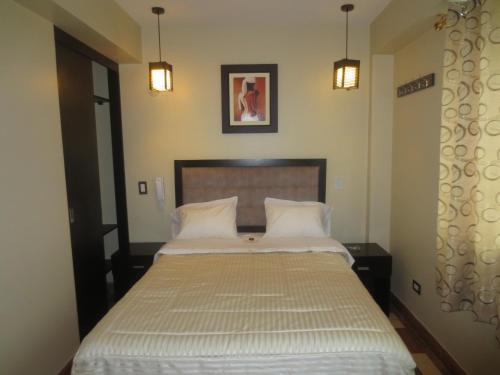 Cama o camas de una habitación en Real Suite