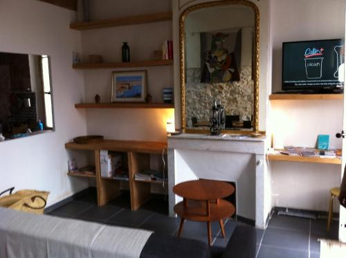A television and/or entertainment center at Adoramaar- le loft