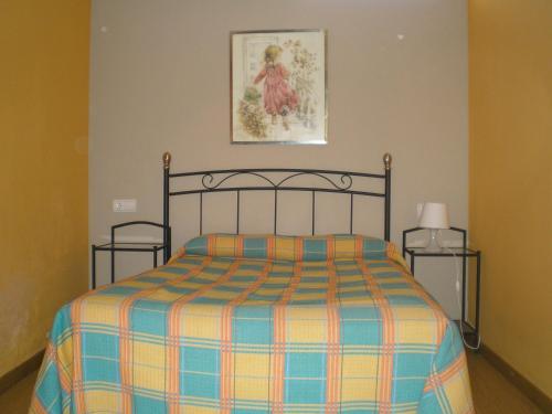 A bed or beds in a room at Apartamentos Turísticos Reyes Católicos