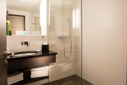 Ein Badezimmer in der Unterkunft Vital Hotel Frankfurt