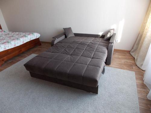 A bed or beds in a room at Apartment Na Respublikanskoy