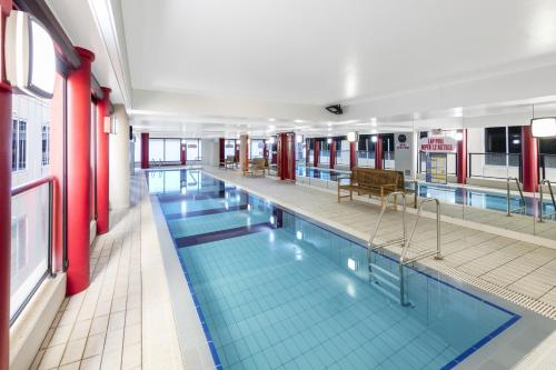 The swimming pool at or near Oaks Adelaide Horizons Suites