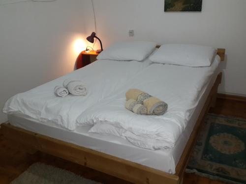 Postelja oz. postelje v sobi nastanitve Happy Dreams Apartment