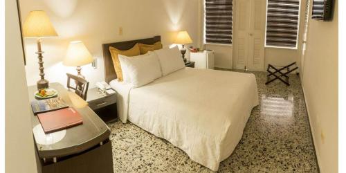 Cama o camas de una habitación en Hotel Tequendama Inn Estación