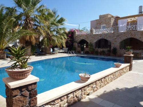 The swimming pool at or close to Atalos Suites