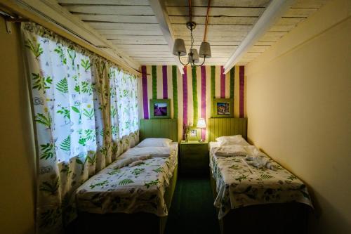 Кровать или кровати в номере Круассан Отель и Пекарня