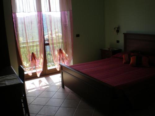 Letto o letti in una camera di Orchidea Selvatica B&B