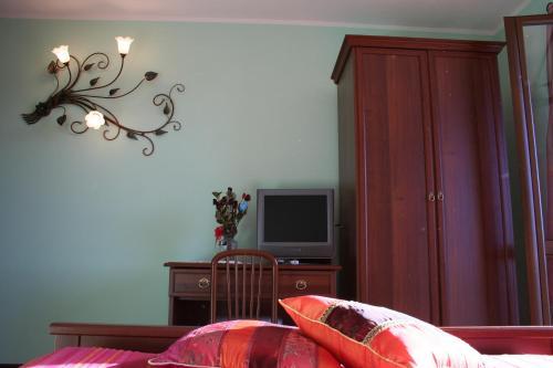TV o dispositivi per l'intrattenimento presso Orchidea Selvatica B&B