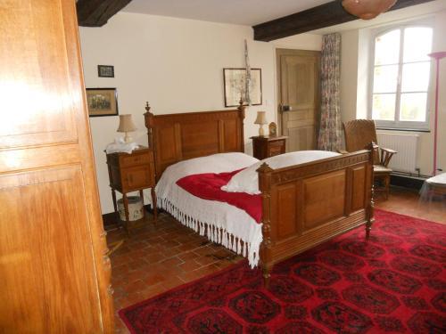 Un ou plusieurs lits dans un hébergement de l'établissement Ferme De Guersignies B&B