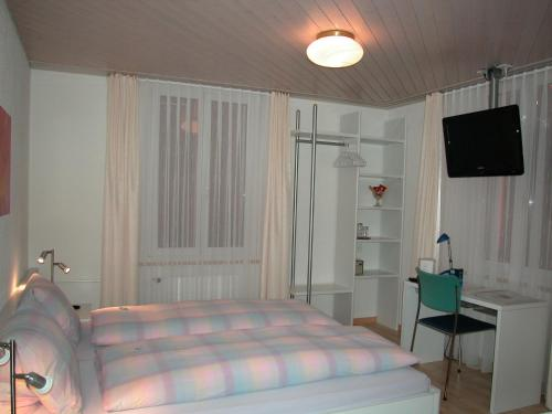 A bed or beds in a room at Hotel Sporting