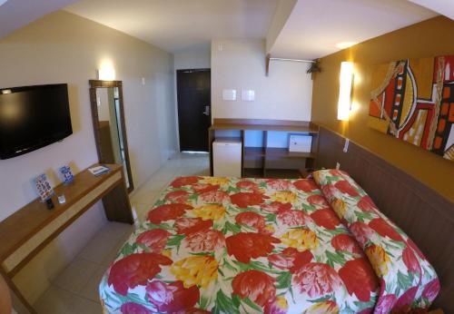 Cama ou camas em um quarto em Atol das Rocas Hotel