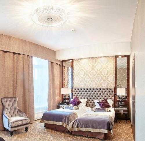A bed or beds in a room at Majestic Boutique Hotel Deluxe