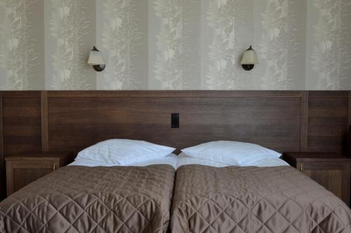 A bed or beds in a room at Šaulys