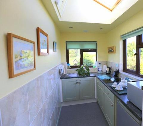 A kitchen or kitchenette at Pheasant Suites
