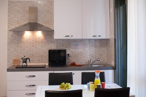 A kitchen or kitchenette at Visit Cagliari