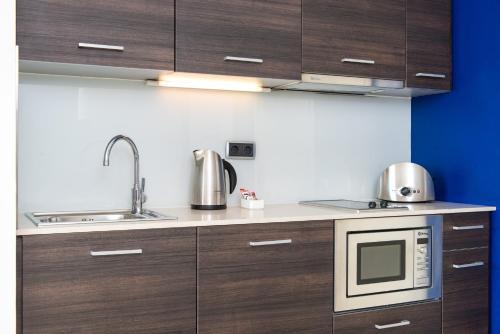 Capri by Fraser Barcelona tesisinde mutfak veya mini mutfak
