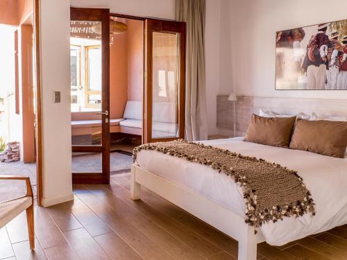 Cama ou camas em um quarto em NOI Casa Atacama