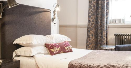 A bed or beds in a room at Great John Street Hotel