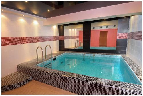 The swimming pool at or close to Colibri Hotel