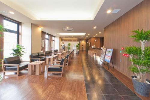 The lobby or reception area at Hotel Route-Inn Saiki Ekimae