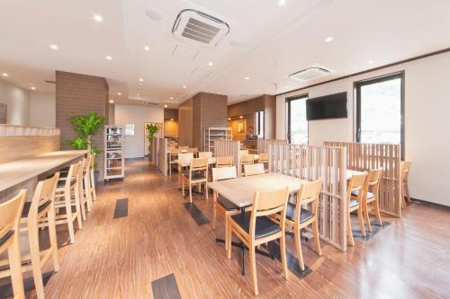 A restaurant or other place to eat at Hotel Route-Inn Saiki Ekimae