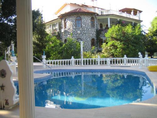 The swimming pool at or near Romantik Villa Apartment Bungalow