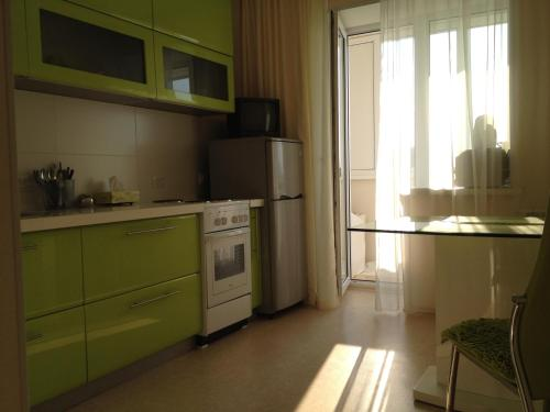 A kitchen or kitchenette at Sedanka-City Apartment