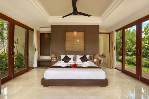 A bed or beds in a room at Khayangan Kemenuh Villas by Premier Hospitality Asia