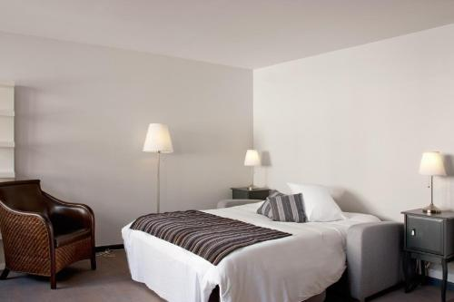 A bed or beds in a room at Appart' Brest