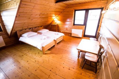 Łóżko lub łóżka w pokoju w obiekcie Villa Miodula - Wisła/Soszów Happy Wisła House