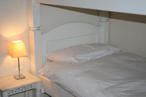 A bed or beds in a room at BCC Loch Ness Cottages