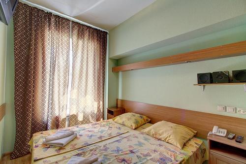 Кровать или кровати в номере Апарт- отель Невский 78