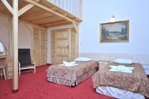 A bed or beds in a room at Pensjonat Stańczyk