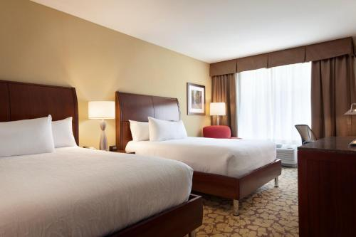 A bed or beds in a room at Hilton Garden Inn Boston Logan Airport