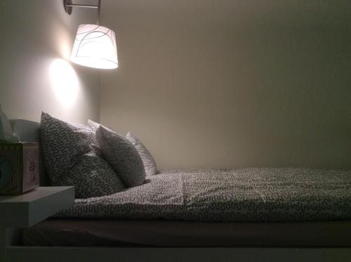 A bed or beds in a room at Apartment Ivory