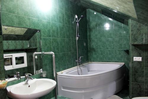 A bathroom at Hotel Central Rustaveli