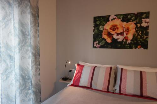 A bed or beds in a room at Grey Rooms Guesthouse
