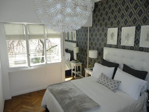 Una cama o camas en una habitación de Apartamento en Recoleta