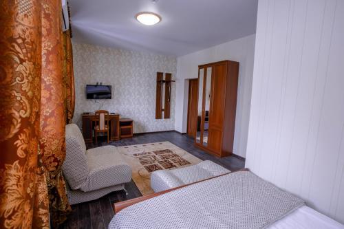 Кровать или кровати в номере Мини-Отель «Тетта»