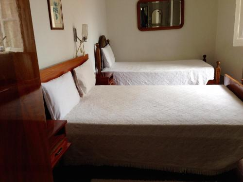 A bed or beds in a room at Residencial Beira