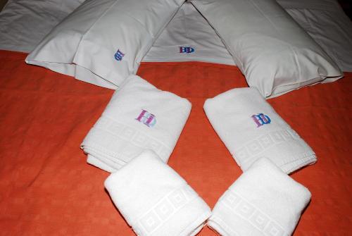 Un ou plusieurs lits dans un hébergement de l'établissement Diethnes Hotel
