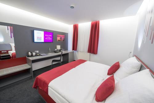 Postel nebo postele na pokoji v ubytování Hotel Villa Eden