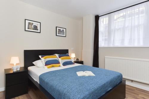 A bed or beds in a room at City Apartments
