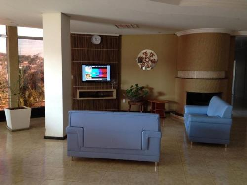 A seating area at Hotel Cedro Palace