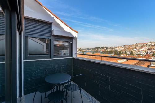 A balcony or terrace at Reis de Gaia